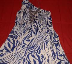 Svecen fustan so etiketa