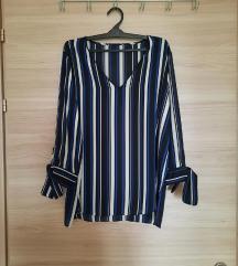 Елегантна блуза на риги