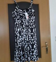 fustan nov so etiketa
