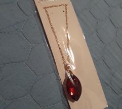 Novo lance zlatno sindzirce crven kamen