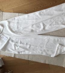 Бели елегантни панталони