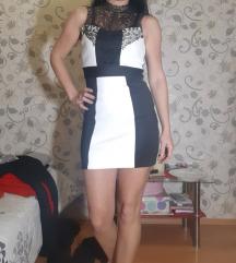 Eleganten crno -bel fustan skroz nov 700