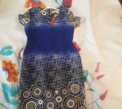 Nov damski fustan so etiketa