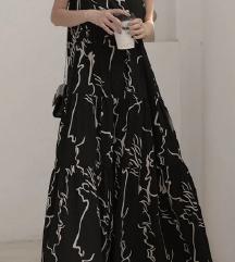 Практичен и модерен долг фустан