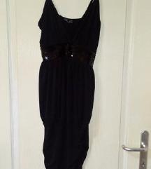 Crn svecen fustan