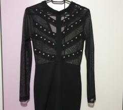 Црно фустанче со детали