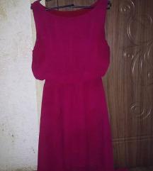 crven asimetricen fustan
