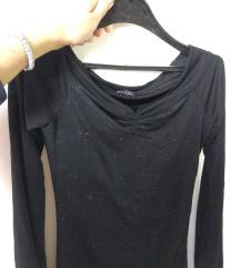 Elegantna bluza so svetki