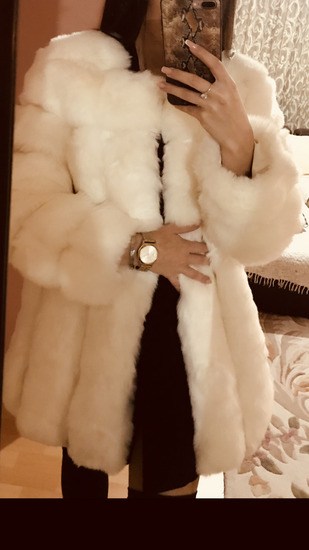 White faux fur coat