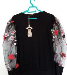 Нова блуза со етикета