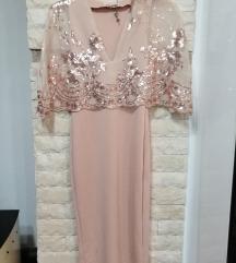 Eleganten fustan namaleno 1900den
