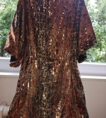 Svecen svetkav fustan